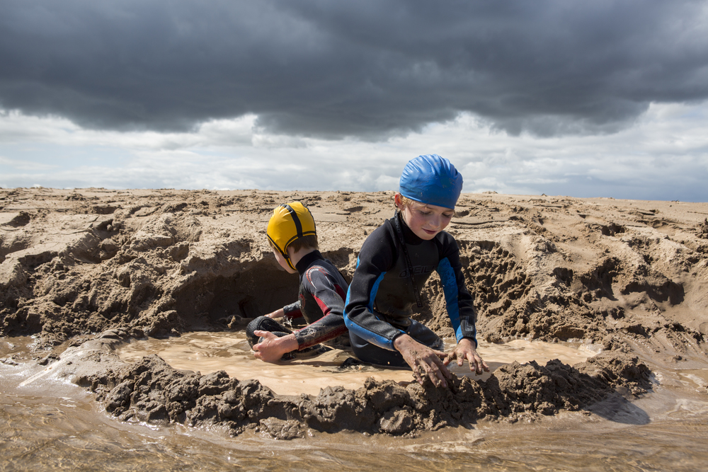 Frayja, 7, and Fergus Hawson, 10, enjoy time playing with sand in Dunbar, Scotland, as rain clouds move in on July 23, 2015. They joined their parents Tom and Jenny, and their dog Beattie, on a sailing vacation along the Scotland coast.