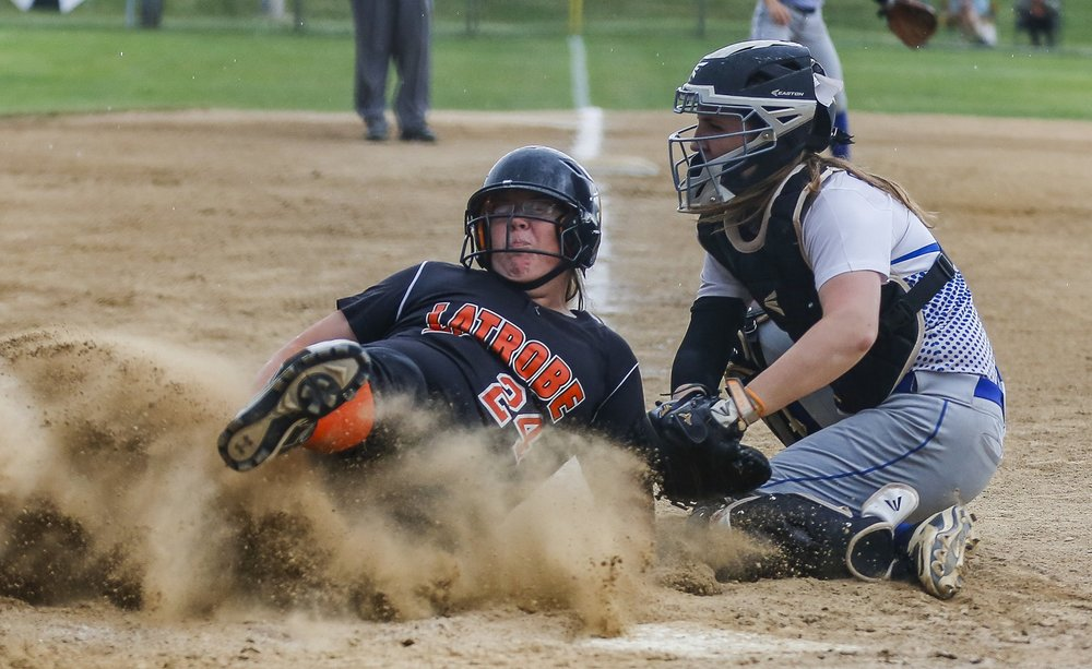 Latrobe infielder Aimee Siecinski is tagged out at home plate by Hempfield catcher Madison Stoner during the first round of PIAA playoffs at California University on Monday, June 6, 2016 in California. Hempfield won 4-0.