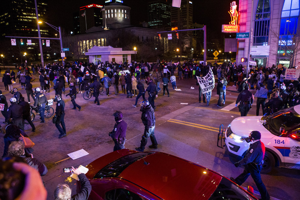 9:04 p.m. – Police continue to clear the streets and remain until protesters are back onto the sidewalks.