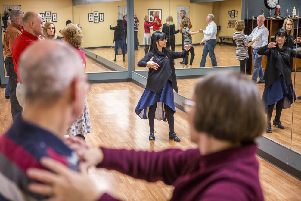 Luanne O'Brien, owner and instructor at Integral Ballroom in Murrysville, Pennsylvania, teaches a class of four couples on Thursday, Dec. 22, 2016.