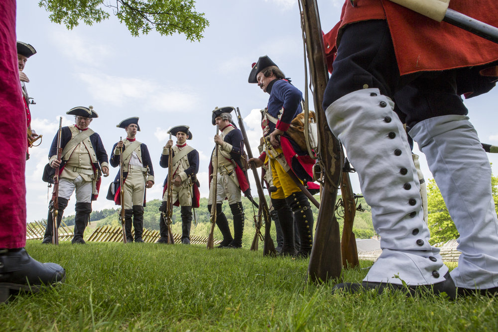 Reenactors of the 60th Royal American Regiment await the start of a battle reenactment with French forces at Fort Ligonier during Military History Weekend on Saturday, May 28, 2016 in Ligonier, Pennsylvania.