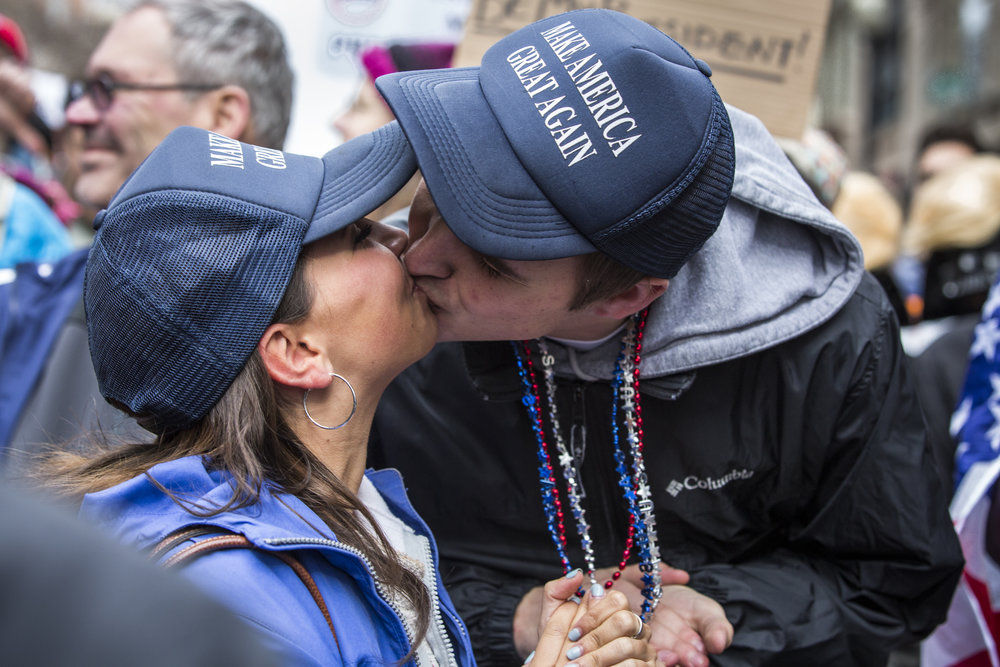 Austin Phillips and Kristy Lowenkron of Baltimore celebrate following the swearing in of President Donald Trump in Washington, D.C., on Inauguration Day 2017.