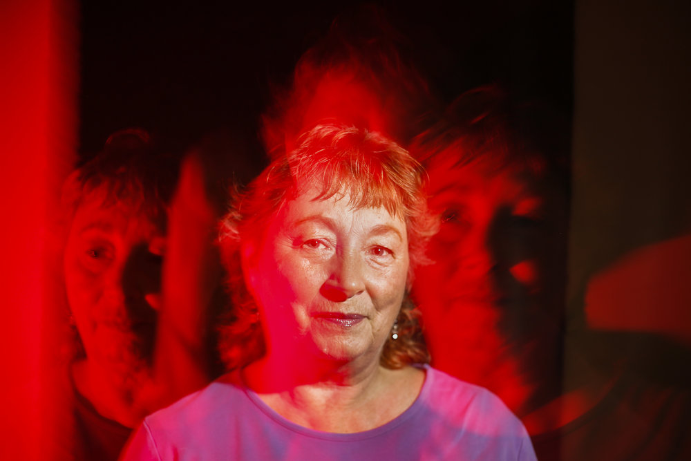 Nancy DeLaval Miller poses for a portrait on August 31, 2015. Having been sexually assaulted as a child, Nancy developed dissassociative identity disorder when she was 50 and has around 14 different personalities. DeLaval Miller describes her personalities as living in a long hallway with different personalities stepping out of their rooms to come out. In camera multiple exposure (4 exposures total).