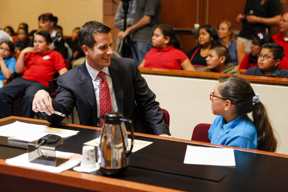 "Christopher Pandelis, chief deputy district attorney, talks with Zitlalic Salinas, the plaintiff and a fifth grader from C.P. Squires Elementary School, following a mock trial as a part of the ""Kids in the Court"" program at the North Las Vegas Justice Court on Tuesday, May 9, 2017. Salinas said she hopes to become a lawyer someday. Patrick Connolly Las Vegas Review-Journal @PConnPie"