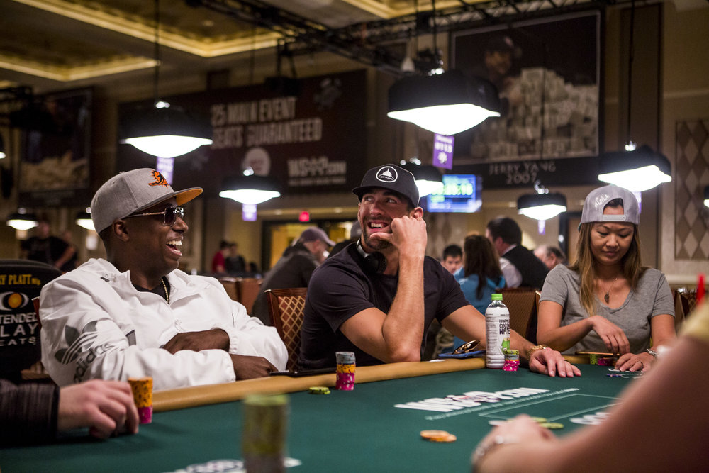 Olympic swimmer Michael Phelps shares a moment with poker star Maurice Hawkins during a tag team event in the opening of the World Series of Poker at the Rio Convention Center on Wednesday, May 31, 2017. Patrick Connolly Las Vegas Review-Journal @PConnPie