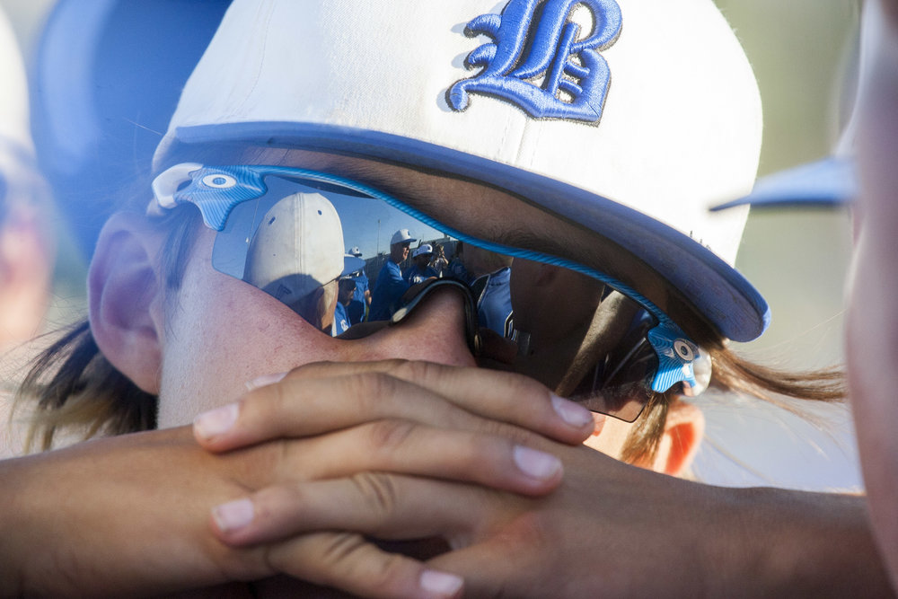 Basic players are reflected in sunglasses during a post-game huddle after their victory against Coronado, 7-3, at Basic High School in Henderson on Thursday, May 11, 2017. Patrick Connolly Las Vegas Review-Journal @PConnPie