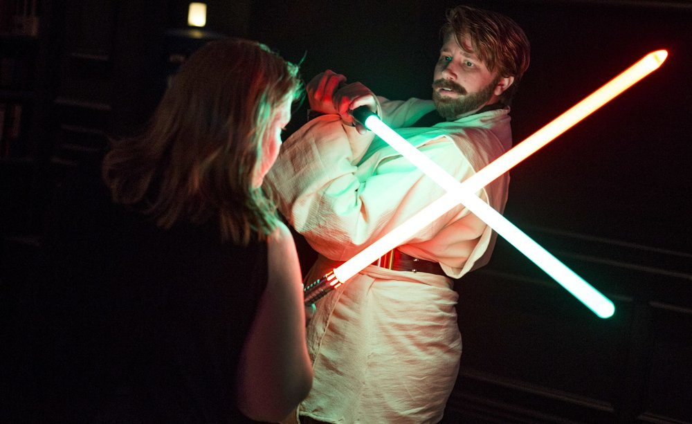 Amanda Bond, left, and Rebecca Zobell, dressed as Obi Wan Kenobi, practice their lightsaber skills as they celebrate the 40th anniversary of the release of Episode IV – A New Hope at the Millennium Fandom Bar in the Arts District on Thursday, May 25, 2017. Patrick Connolly Las Vegas Review-Journal @PConnPie