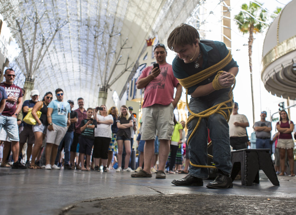Street magician Will Bradshaw attempts to free himself from 100 feet of rope in under 2 minutes on Fremont Street in Las Vegas on Tuesday, May 16, 2017. Bradshaw has lived in Las Vegas permanently for two years and performs anywhere between two and five days a week on the street. Patrick Connolly Las Vegas Review-Journal @PConnPie