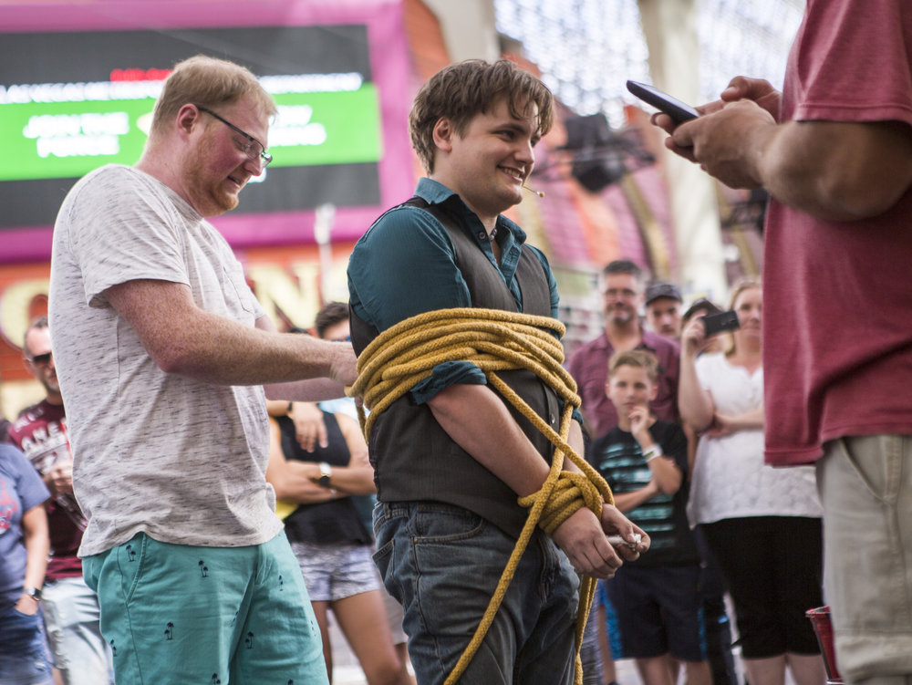 Jordan Lewis of Portland, Oregon, left, assists in tying up street magician Will Bradshaw on Fremont Street in Las Vegas on Tuesday, May 16, 2017. Bradshaw has lived in Las Vegas permanently for two years and performs anywhere between two and five days a week on the street. Patrick Connolly Las Vegas Review-Journal @PConnPie