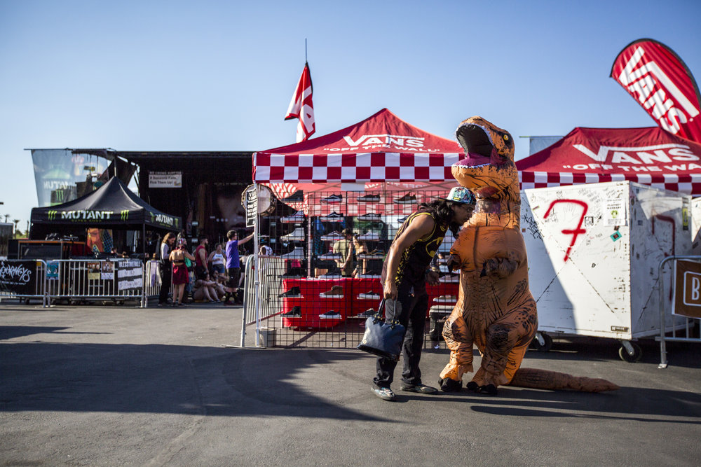 Larry Sanroman checks on his friend Jennifer Paddock in her dinosaur costume at Vans Warped Tour at the Hard Rock Hotel and Casino on Friday, June 23, 2017.  Patrick Connolly Las Vegas Review-Journal @PConnPie
