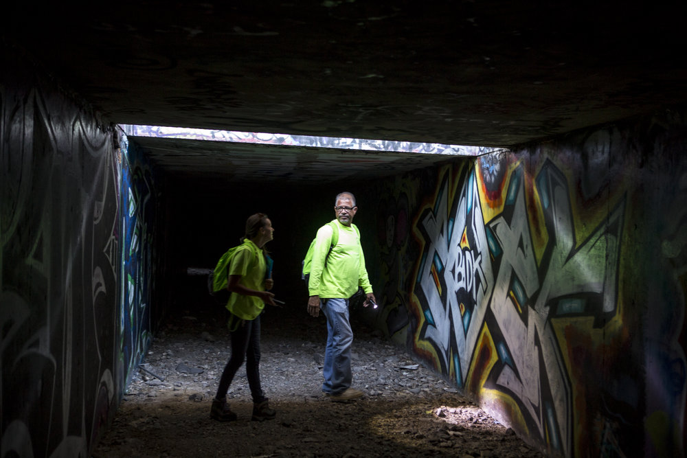 HELP of Southern Nevada employees Louis Lacey and Hayli Petcoff pause in a patch of light underneath Interstate 15 in a flood tunnel near the Hard Rock Hotel and Casino on Tuesday, June 27, 2017.  Patrick Connolly Las Vegas Review-Journal @PConnPie