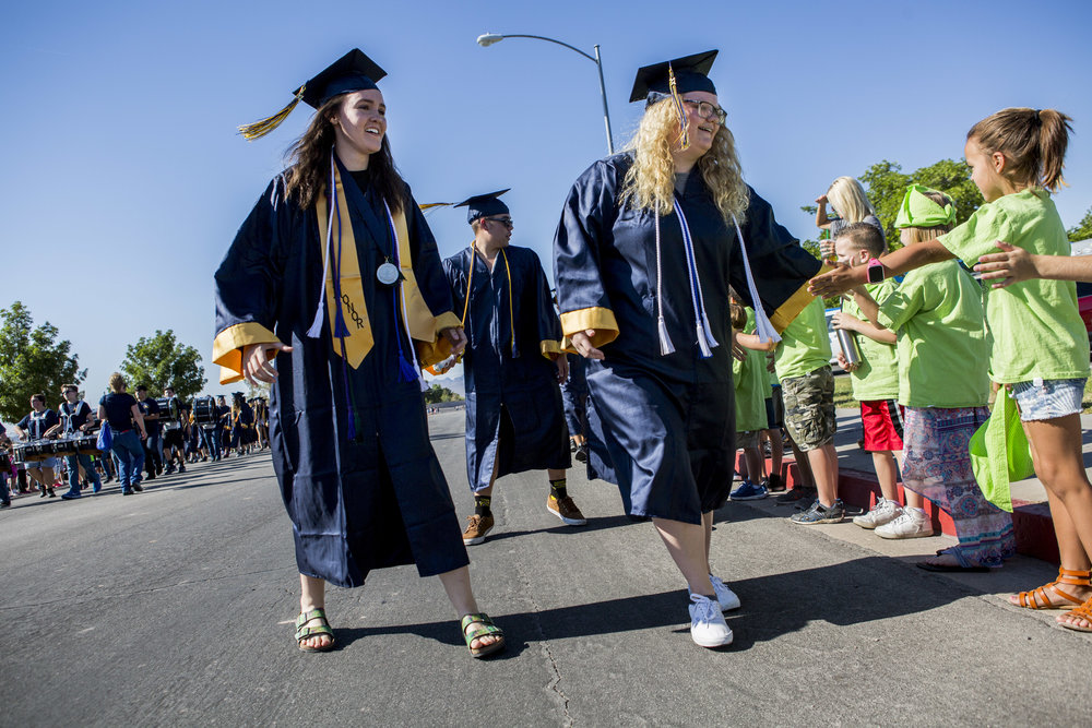 Boulder City High School seniors high five elementary schoolers in an annual Grad Walk to celebrate the seniors' accomplishments and encourage young students to finish high school.