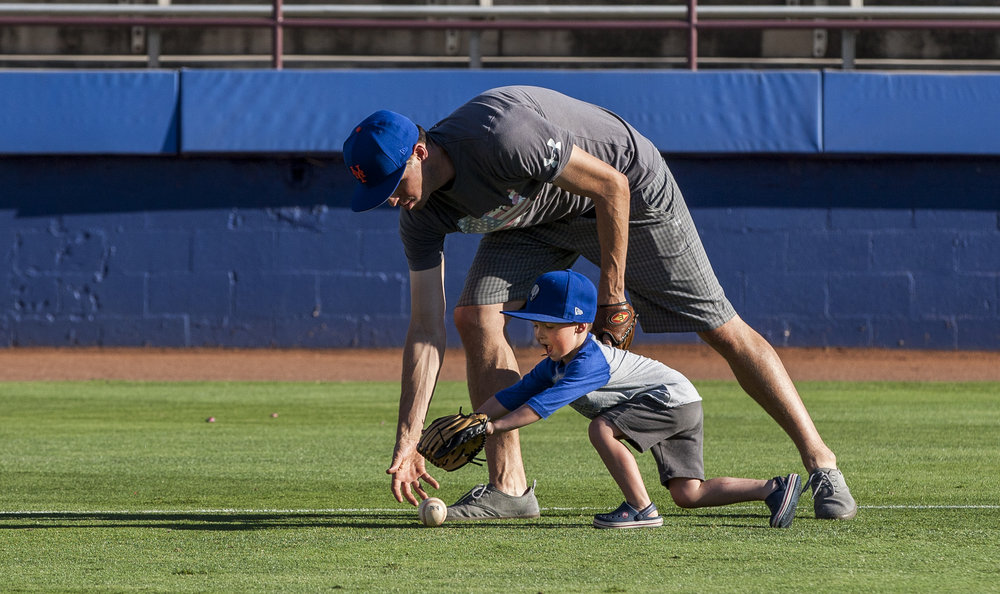 Dillon Truman, 4, races for the ball with his father Jared during father and child catch, an annual tradition, before the Las Vegas 51s game at Cashman Field on Friday, June 16, 2017.