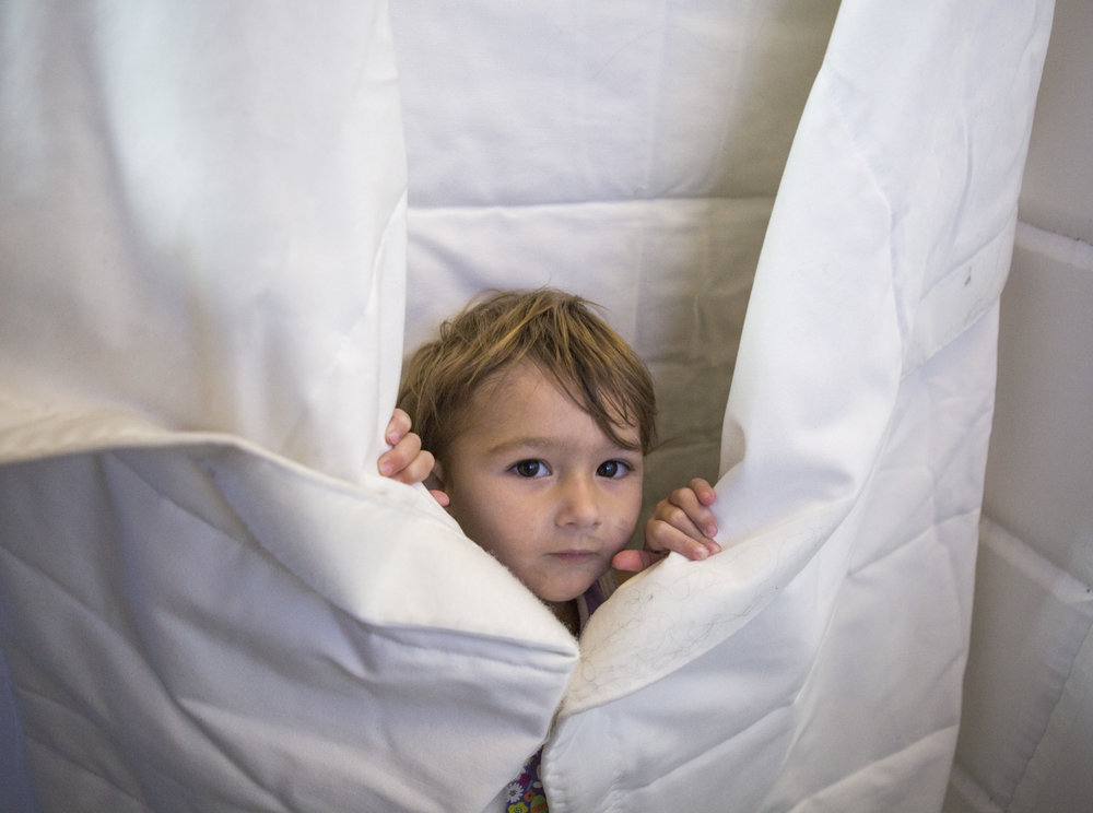 River Apfel, 2, tries out a space sleeping bag at the Astronaut exhibit at the Springs Preserve.