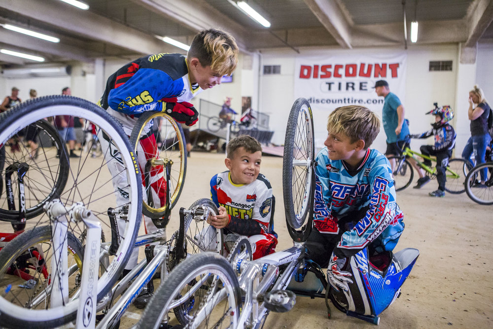 (left to right) Troy Griffin, 11, Reese Griffin, 7, and Tyler Cowell, 11, of Gilroy, Calif, hang out in between races at the USA BMX 2017 Las Vegas Nationals at South Point Arena on Sunday, July 16, 2017.