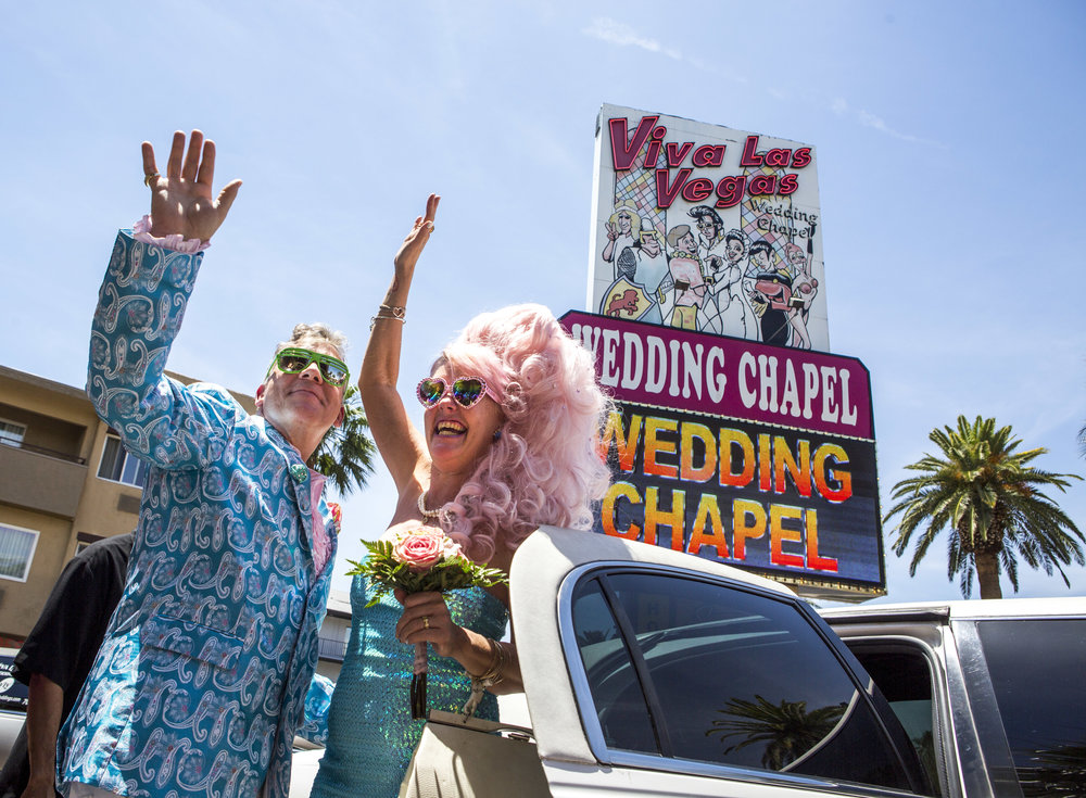 Andrea Cambridge and Chuck Varga wave goodbye to wedding guests after their Liberace-themed wedding at the Viva Las Vegas Wedding Chapel on Saturday, June 3, 2017.
