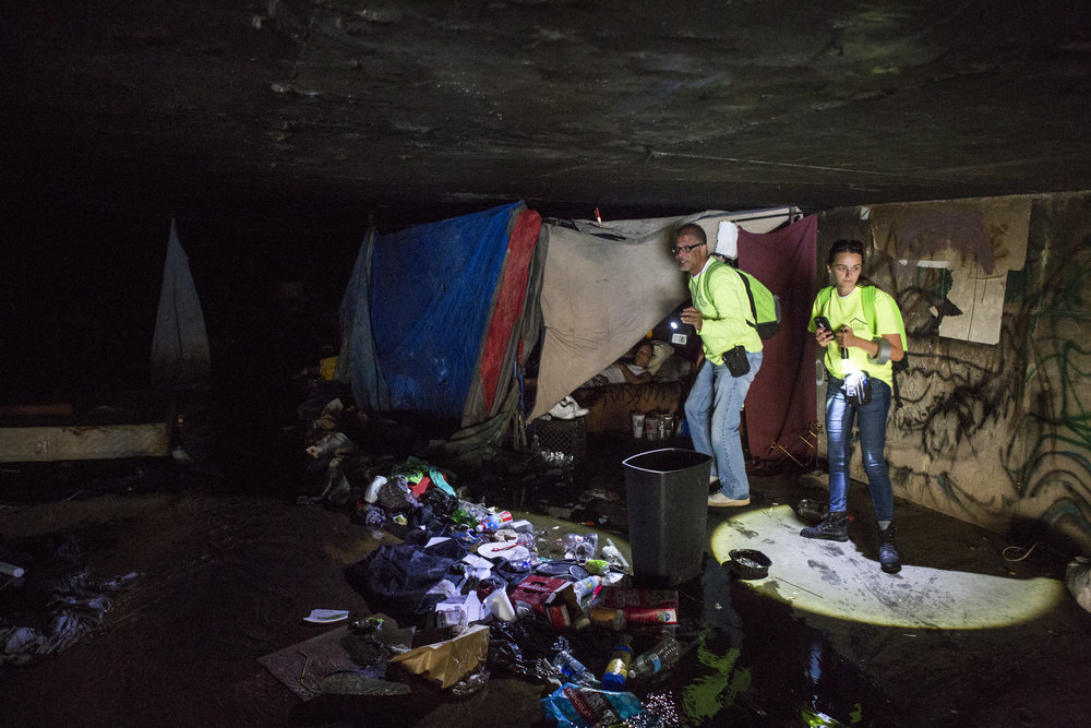 HELP of Southern Nevada employees Louis Lacey and Hayli Petcoff check on a homeless man in a flood tunnel near the Hard Rock Hotel and Casino on Tuesday, June 27, 2017. After two homeless people died in early monsoon rains the previous year, Lacey and his team make it a priority to warn tunnel residents about potential rain.