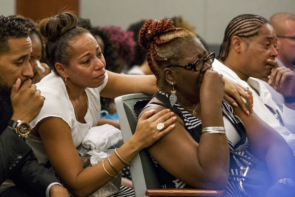 Ramona Gantz, center left, comforts Debra Pleasant, center right, the grandmother of Roland Pleasant, during the sentencing for Eric Javon Bell, who pleaded guilty to killing 18-year-old Roland Pleasant, at the Regional Justice Center in Las Vegas on Monday, July 17, 2017.