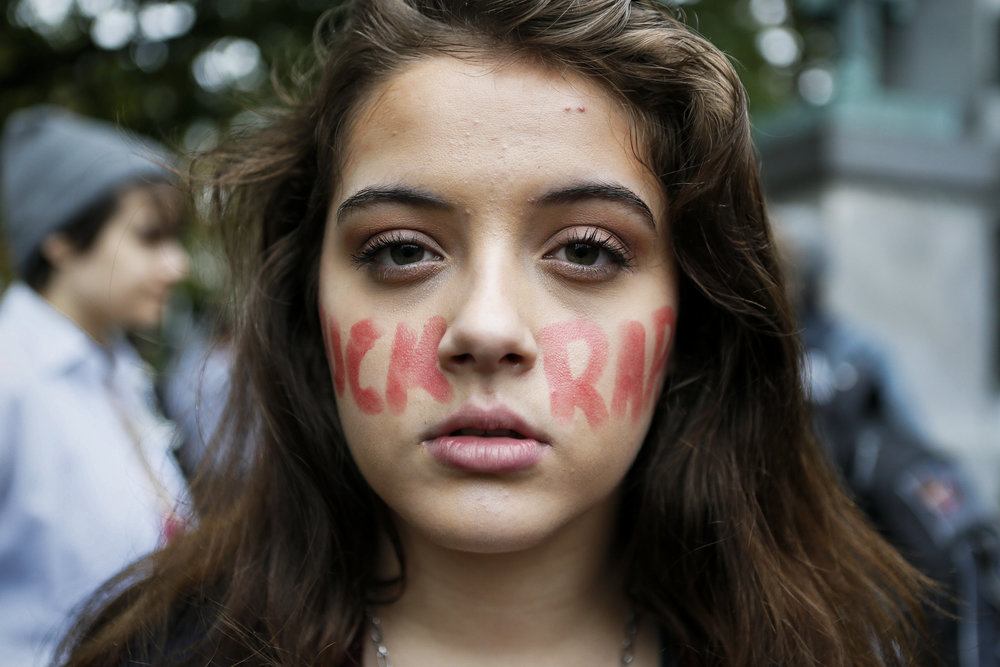 Carly Preston, a freshman studying political science and journalism, displays her facepaint after the FuckRapeCulture march on Friday, Oct. 10, 2014. FuckRapeCulture is a campus organization that seeks to raise awareness about rape culture at Ohio University.