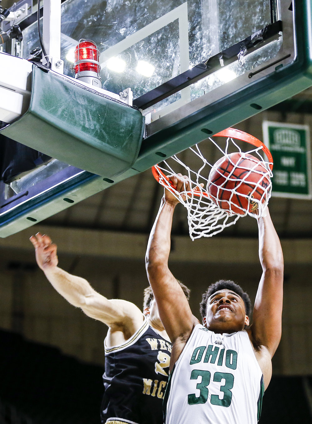Ohio forward Antonio Campbell dunks against Western Michigan guard Taylor Perry in the Convocation Center on Jan 19. Ohio won 82-64. (PATRICK CONNOLLY | STAFF PHOTOGRAPHER)