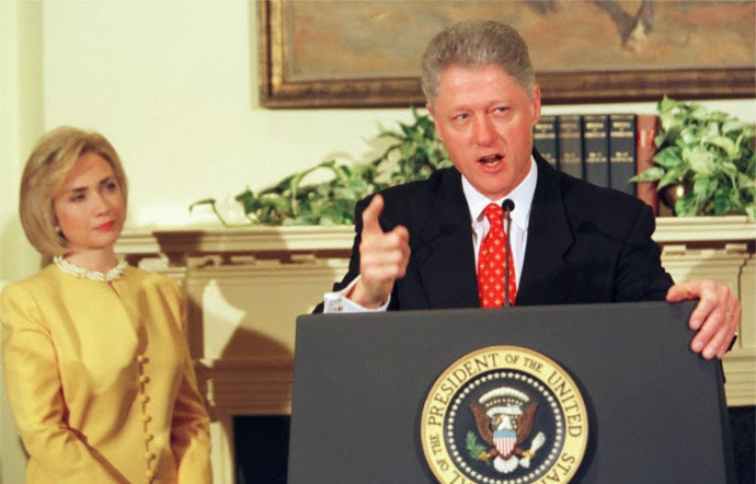 "Bill, in 1998, makes his infamous declaration, ""I did not have sexual relations with that woman,"" as Hillary looks on."
