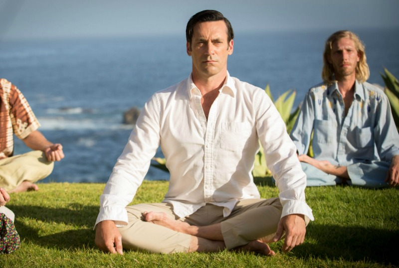 "Don Draper (Jon Hamm) meditates on a hill in California in the series finale of Mad Men, ""Person to Person"" (Image © AMC/Lionsgate)."