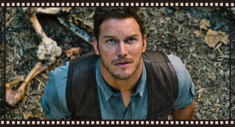 Chris Pratt stares down a dinosaur (not pictured) in Jurassic World (Image  ©  Universal).