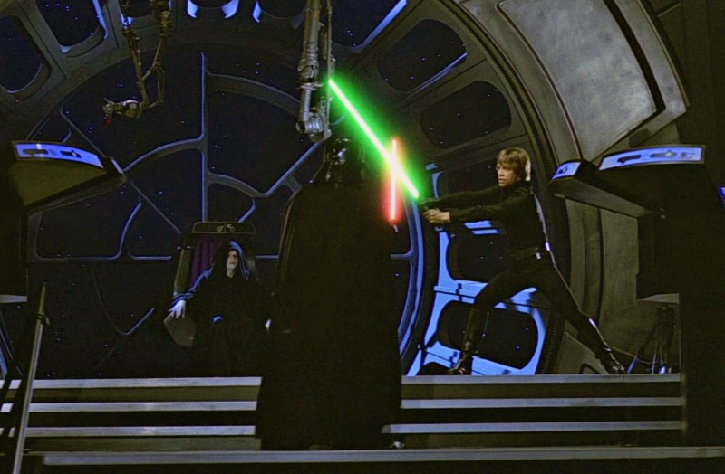 Luke Skywalker and Darth Vader face off, as Emperor Palpatine looks on (Image © Lucasfilm/Disney).