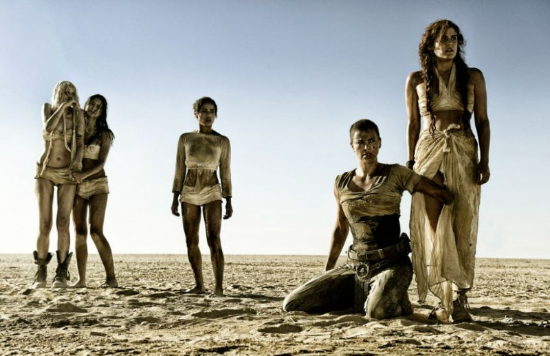 Charlize Theron and the women she's protecting in Mad Max: Fury Road (Image  ©  Warner Bros.)