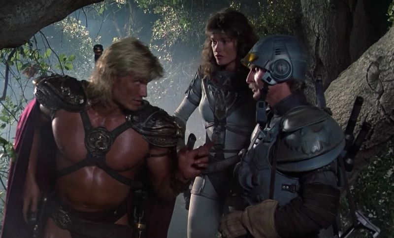 Dolph Lundgren, and Chelsea Field, and John Cypher in Masters of the Universe (Image  ©  Cannon Films).