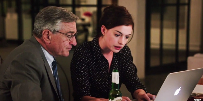 Robert DeNiro and Anne Hathaway star in The Intern (Image © Warner Bros.).