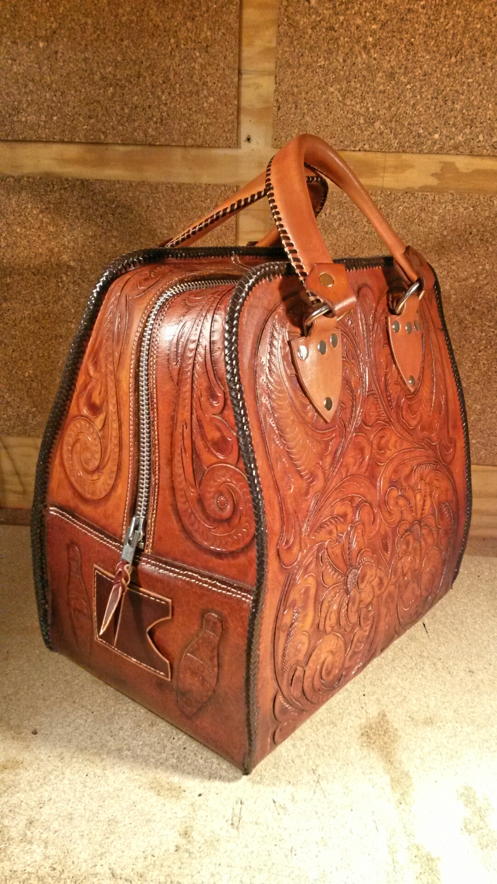 """I don't know where to start. I was brought to tears when I was presented with the bowling bag. I'm seriously blown away! I never expected to see such an amazing restoration! I just wanted a new zipper. I always appreciated the craftsmanship that went into making the bag, but you clearly have another level of appreciation and talent for leather work. This bag is priceless, I will cherish this bag until the day I die. I can't thank you enough!"" David M. - CO"