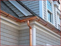 """Copper - These are aesthetically the most pleasing to the eyes. They are beautiful to look at and have a """"higher end"""" look. They come in various styles as in half round and K-style. These types of gutters are more expensive than the normal aluminum gutters due to the material cost and the workmanship required to install them. Copper gutters need to soldering at seams and downspout areas. They last a very long time, normally more than 50 years if installed correctly."""