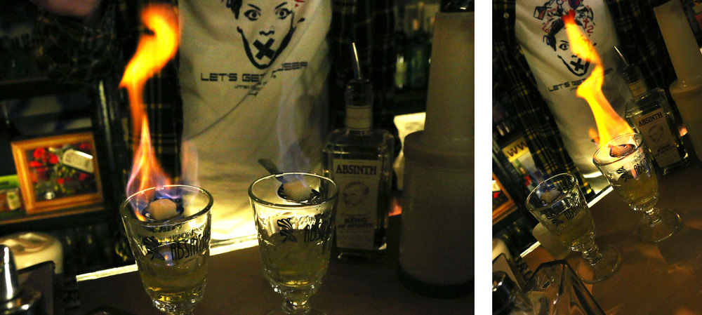 Watching a barman prepare our absinthe drinks.