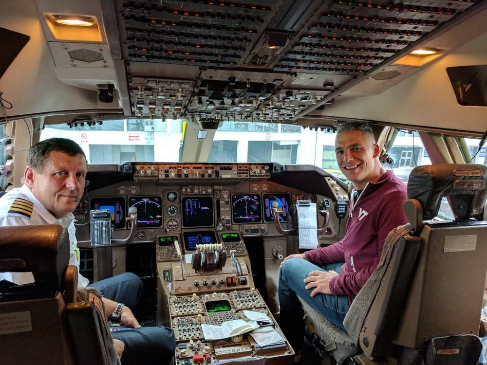 Virginia Tech fan Richie Weldon in the cockpit of his United 787 Dreamliner.  Weldon flew from China to Blacksburg and back for the Hokies' game with Clemson this season.