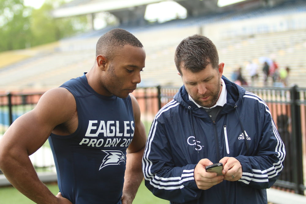 Bryan Johnston confers with current San Francisco 49er Matt Breida at Georgia Southern's 2017 Pro Day.