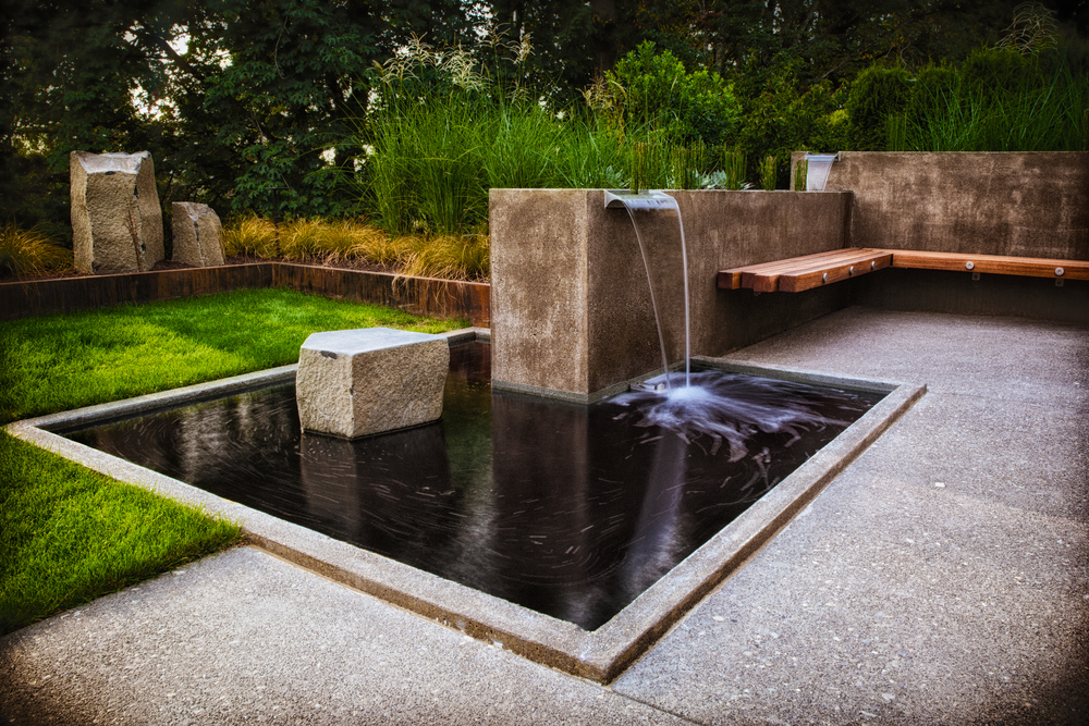 Concrete Water Feature with Spillways, River Rock and Reeds, Batu Bench, and Basalt Boulder