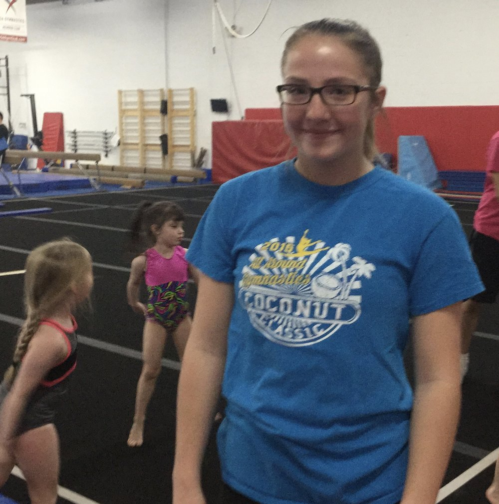 Coach Alexis - Coach Alexis was a gymnast for AAG since she was 6 years old and begun coaching last year. She coaches Beginner Girls every week. She enjoys coaching because she loves to see the kids learn new tricks and to see them smile everyday when they come to practice.