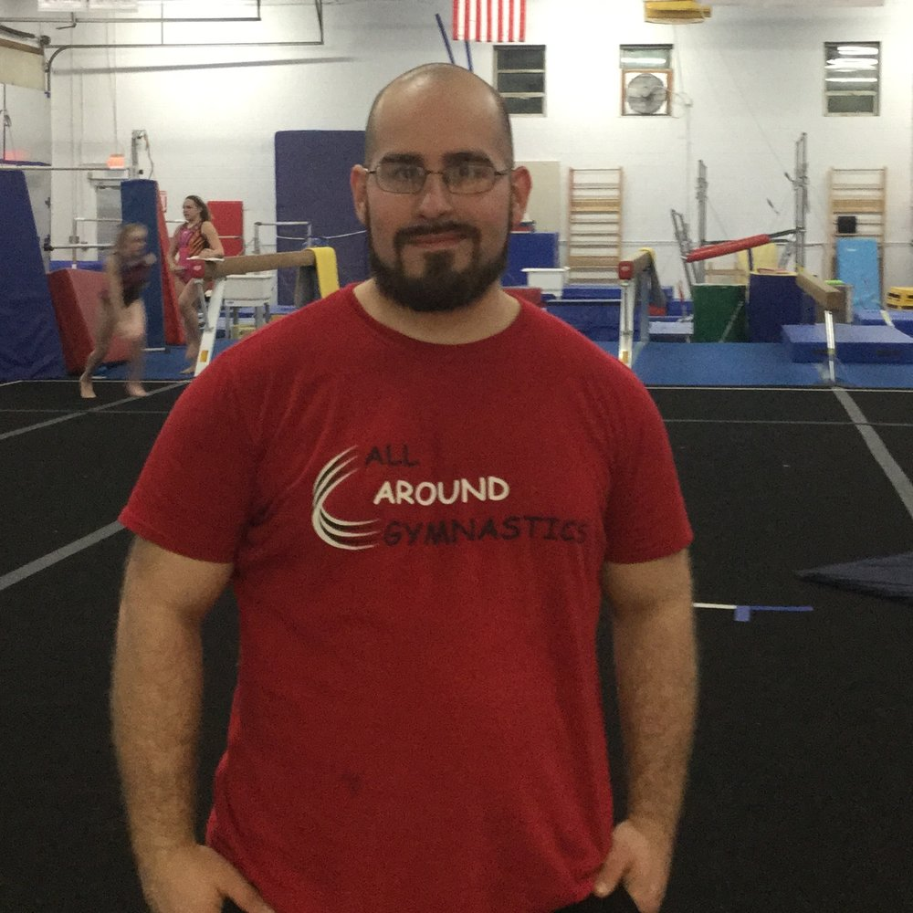 Coach Nate - Nate has coached the sport for over 10 years because he enjoys helping kids improve and build their confidence. He is qualified to coach any class we have, but works mostly with boys' recreational classes and the team levels. He is an ACE certified personal trainer, is Cooper Institute Law Enforcement Fitness certified and is AHA CPR/AED certified (2017). Nate also has a history performing in circus arts.