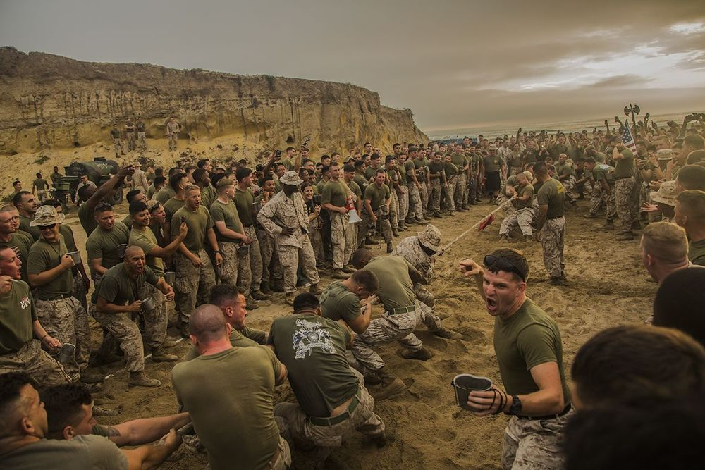 1st Place in the Features category: U.S. marines with 1st Light Armored Reconnaissance Battalion, 1st Marine Division participate in a tug of war competition during warrior night at Marine Corps Base Camp Pendleton, Calif., July 1, 2015. Warrior night is an annual event held to build camaraderie in the battalion. IMAGE: LANCE CPL. RYAN P. KIERKEGAARD, USMC