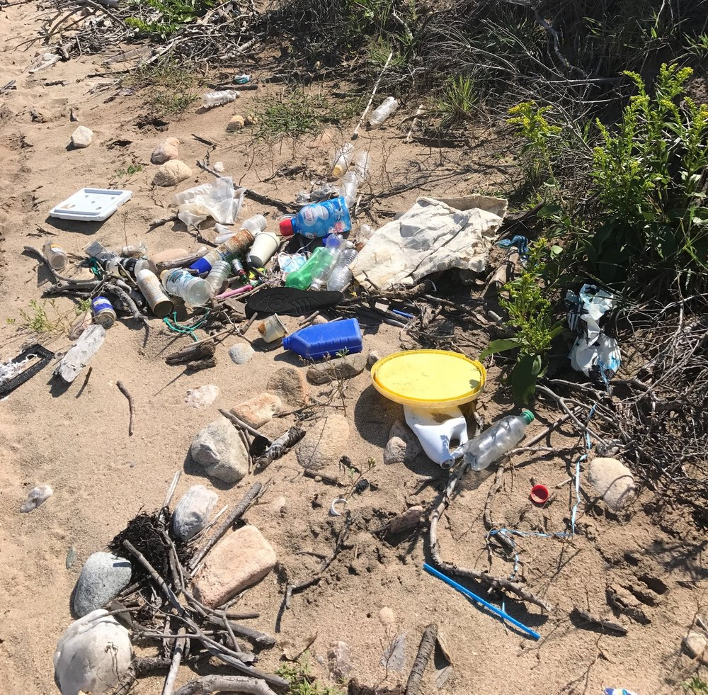 Garbage left by people on the beach at Block Island