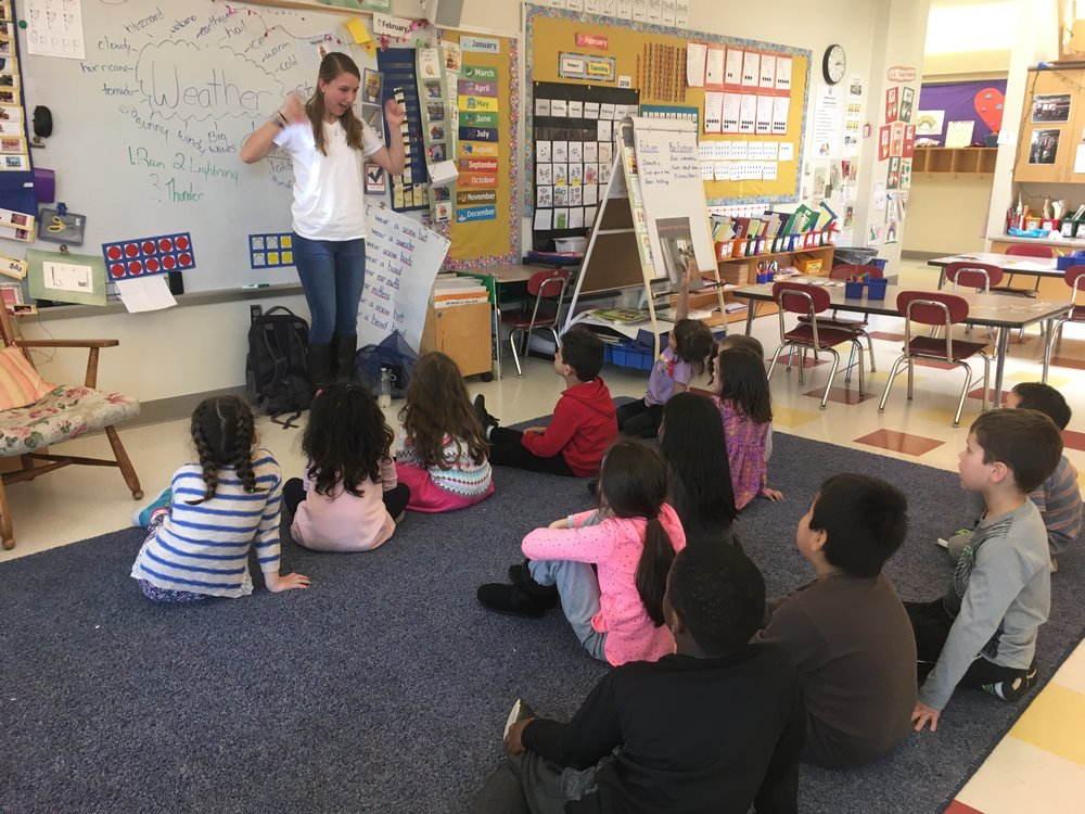 Megan leading a lesson on thunderstorms and their environmental impact at McKinley Elementary School