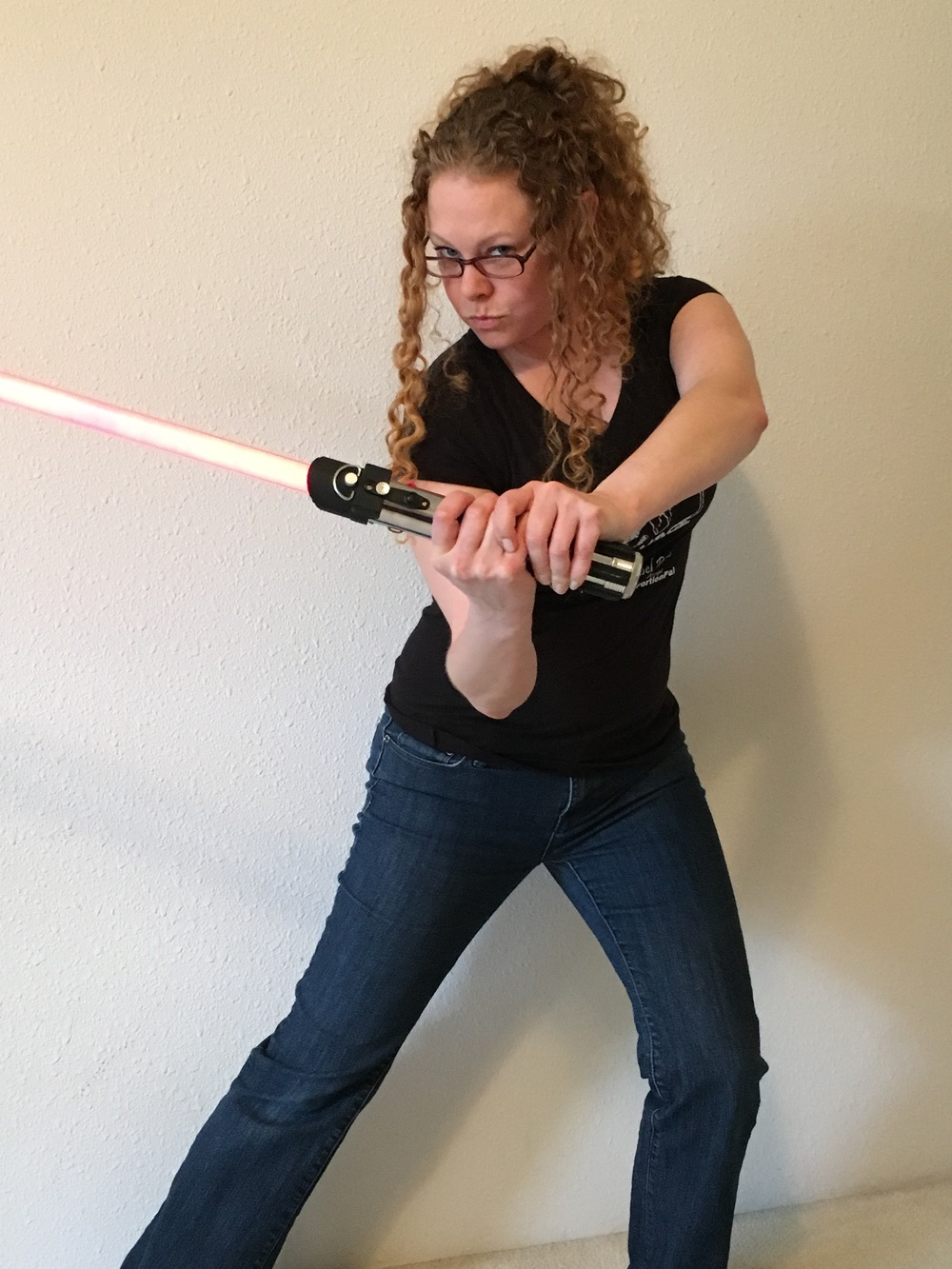 Brittany, productivity, computer CONSULTANT, and ADHD Coach, is having fun with a  light saber. She wants to cut down your  distractions and help you work and live better.