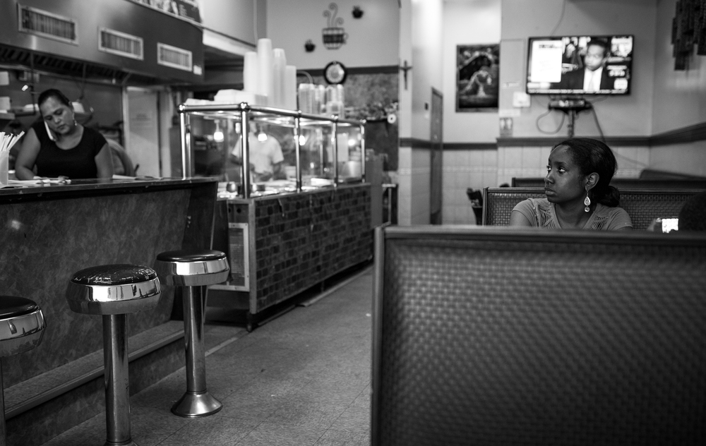 Two customers enjoying a meal in Angie's Breakfast Diner while a waitress takes a phone call. Bushwick is currently made up of 65% Hispanic and 20% African American residents.