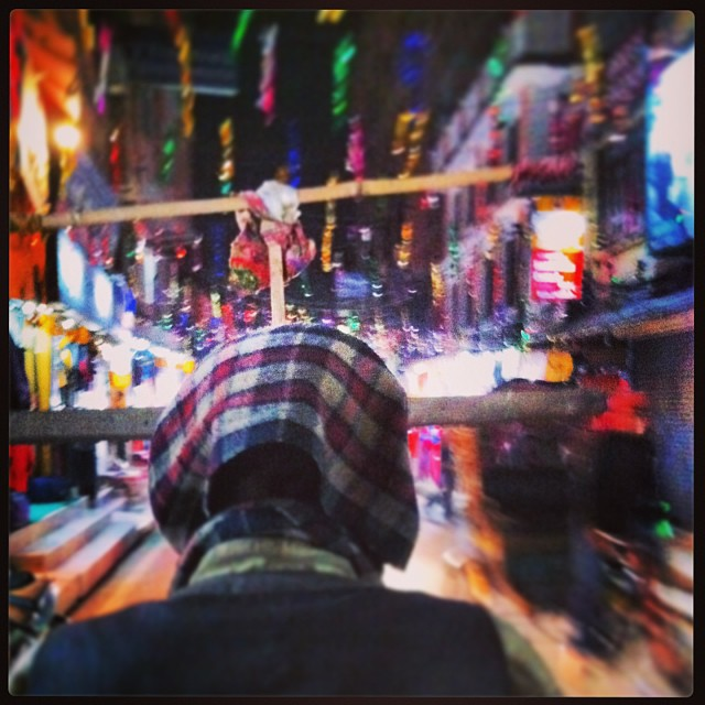A rickshaw ride through the busy tourist area of Thamel