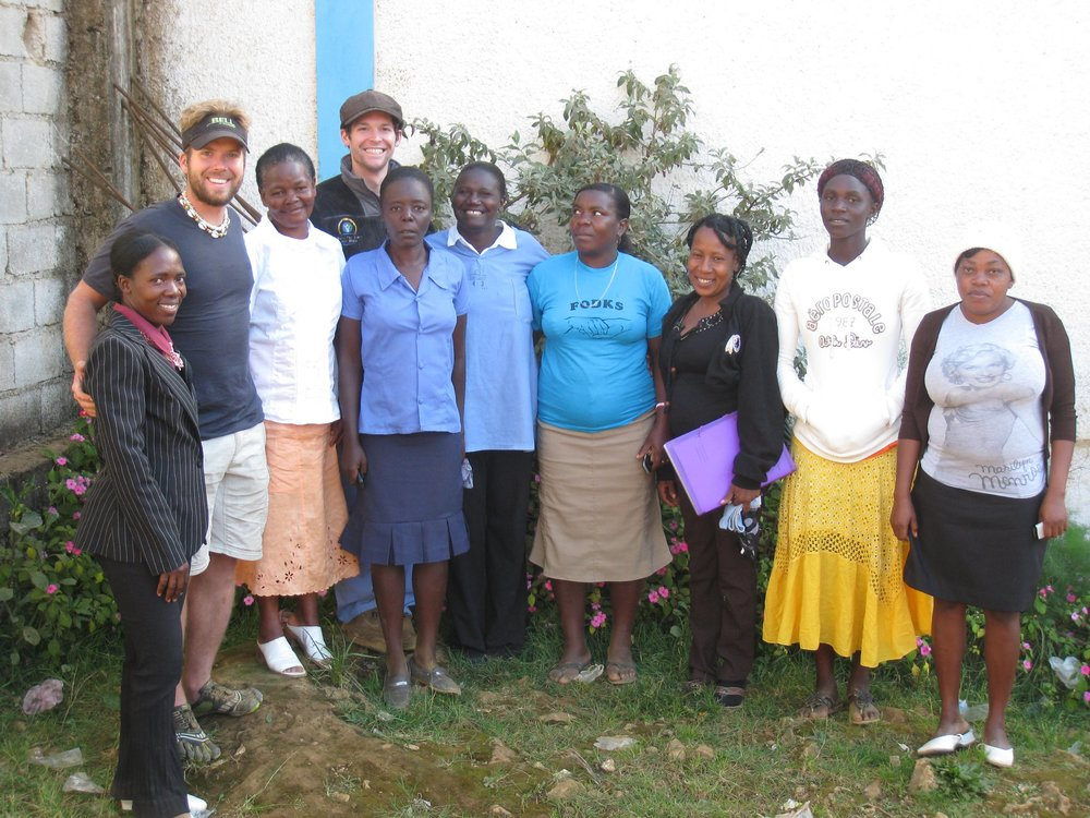 Clayton and Kyle pose with the team of Community Health Workers in Baie d'Orange