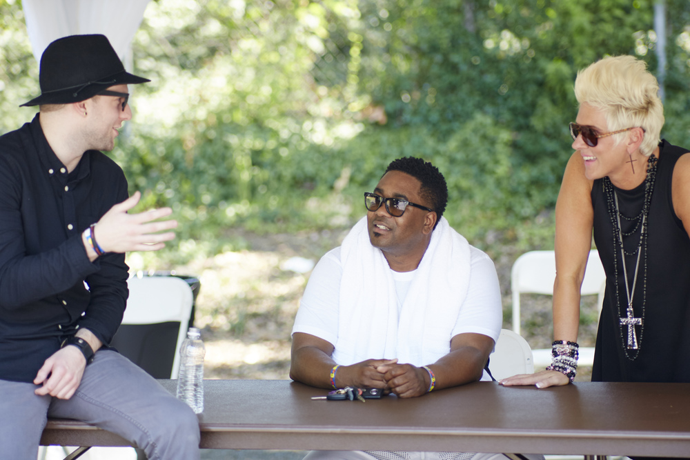 Pastors Judah, Canton and Kim converse in a scene from Preachers of Atlanta (Oxygen Media)