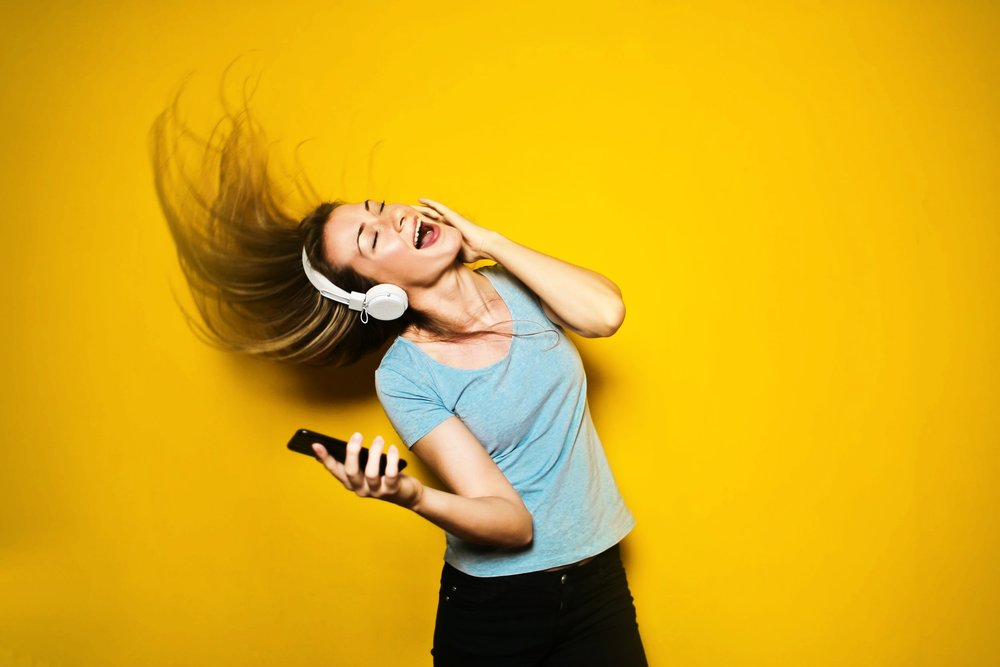 Woman listening to music with headphoines