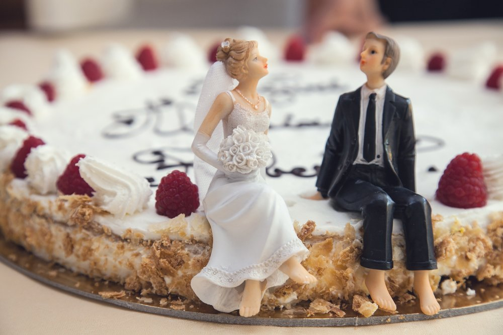 Bride and groom on wedding cake