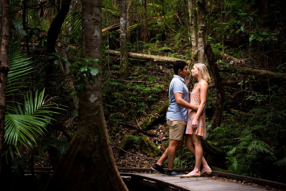Engaged couple on rain forest path sunshine coast hinterland